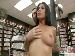 Brunette Cassandra Cruz gives it up in the store with two cocks