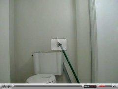 Cute black girl records herself teasing in the bathroom