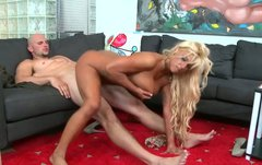 Busty blonde sexpot rides her lover like a cowgirl on a bucking bronco