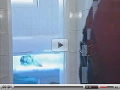 Redhead Teen gets disturbed in the Tanning Booth